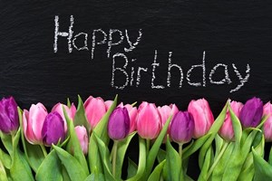 Happy_Birthday_Sign_with_Pink_and_Purple_Tulip__Flowers